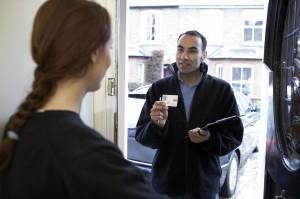 engineer_showing_id_card_at_door